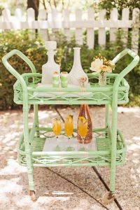 green bar cart tray glasses