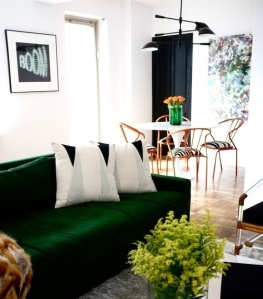 green couch sofa vase pillows
