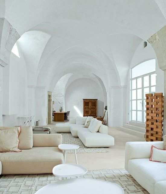 white room couches rugs