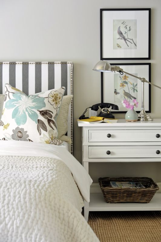 guest bedroom white stripes flowers lamp nightstand