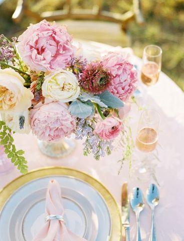 gold and pink inspired tablescape with pastel floral arrangement #tabledecor #weddingreception #weddingchicks www.weddingchicks...