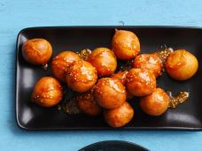 http://www.foodnetwork.com/recipes/food-network-kitchens/rice-fritters-with-sesame-caramel-recipe.html